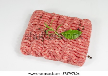 raw minced  meat with onion and rosemary - stock photo