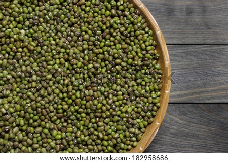 Raw mung beans on  wooden plate