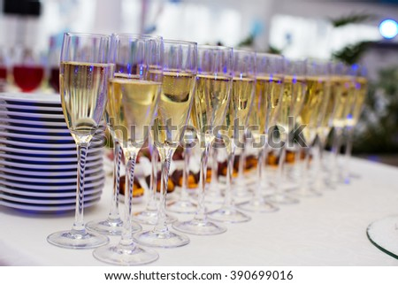 raw of champagne glasses - stock photo