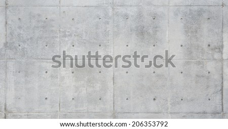 Raw or bare concrete wall, light color, shot with panel seam lines perpendicular to image dimension.  - stock photo