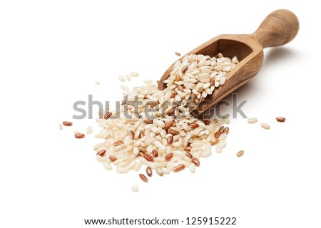 Raw organic brown rice in wooden scoop - stock photo