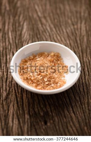 Raw Organic Cane Sugar in a white ceramic bowl - stock photo