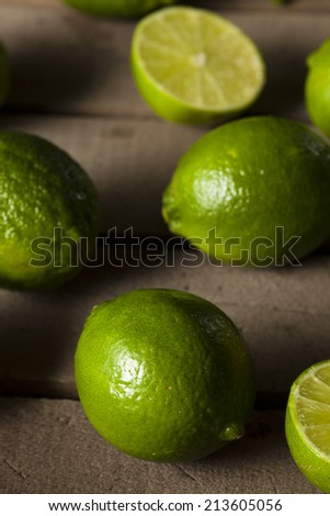 Raw Organic Green Limes on a Background