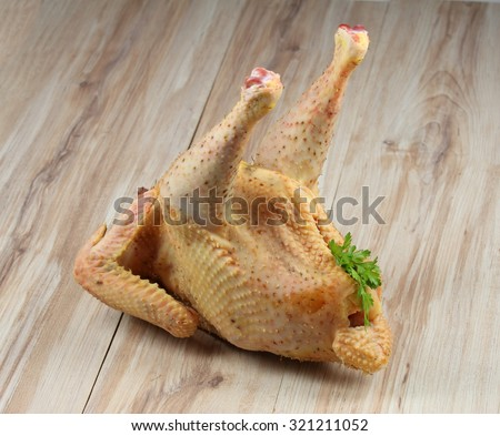 Raw organic rooster  - stock photo