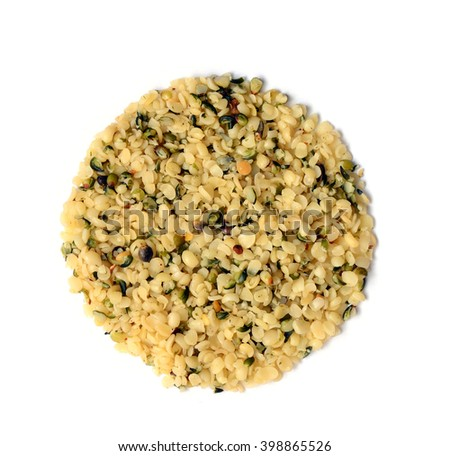 raw organic shelled hemp seeds isolated on white