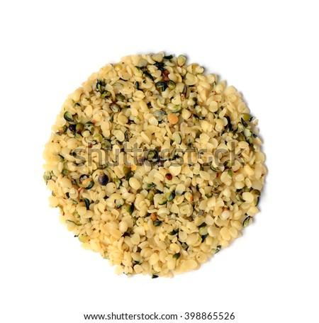 raw organic shelled hemp seeds isolated on white - stock photo