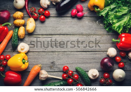 Raw organic vegetables with fresh ingredients for healthily cooking on vintage background, top view, banner. Vegan or diet food concept. Background layout with copy space