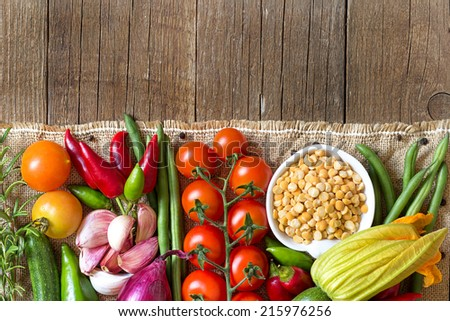 Raw Organic  yellow peas in bowl and vegetables - stock photo