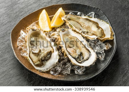 Raw oysters and lemon - stock photo