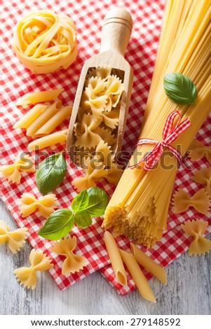 raw pasta farfalle spaghetti penne tagliatelle. italian cuisine - stock photo