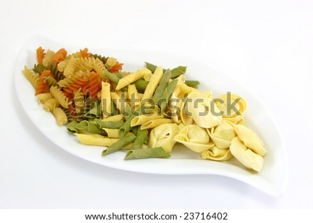 Raw pasta on bright background. Shot in Studio.