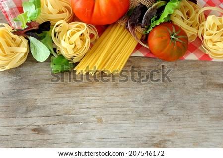 raw pasta with italian ingredients - stock photo