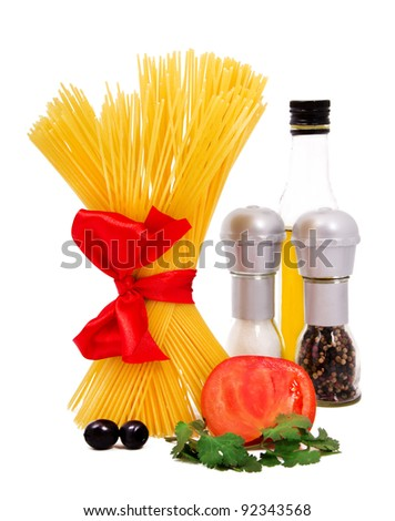 Raw pasta with tomato, oil, pepper and salt isolated on white - stock photo