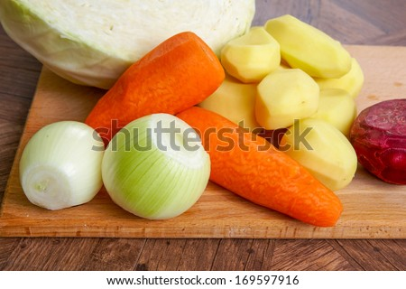 Raw peeled onions, cabbage, beets,  potato, carrots,  for soup - stock photo