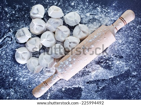raw pelmeni - stock photo