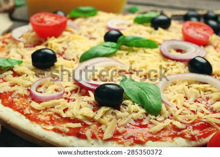 Raw pizza on table close up - stock photo