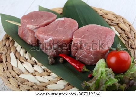 Raw pork fillet mignon ready for cooking - stock photo