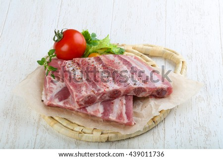 Raw pork ribs with herbs and spices