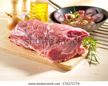 Raw Pork Shoulder Square Cut on kitchen cutting board - stock photo
