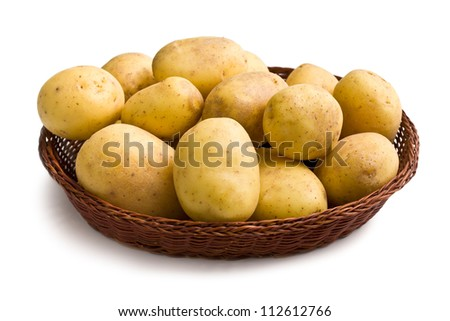 raw potatoes in basket on white background