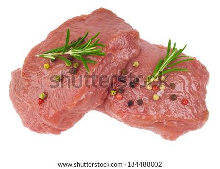 Raw ribeye steak garnished with a sprig of rosemary - stock photo