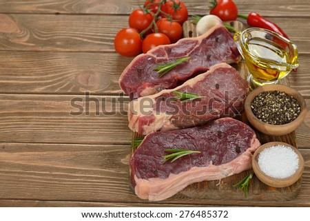 Raw ribeye steak on a brown background - stock photo
