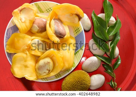 Raw ripe jack fruit cut open, Kerala India. Tropical fruit Jack-fruit (jakfruit, jack, jak).Golden Yellow fruit with seeds .