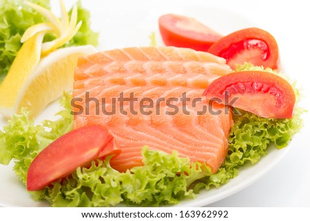 Raw salmon fillet with vegetables - stock photo