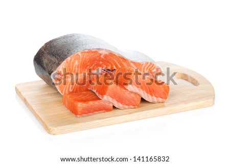 Raw salmon on cutting board. Isolated on white background - stock photo