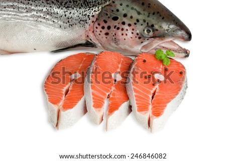 Raw salmon steak and Atlantic salmon - stock photo
