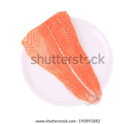 Raw salmon steak. Isolated on a white background. - stock photo