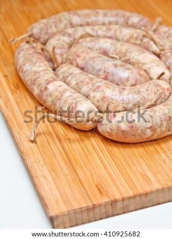 Raw sausage for frying. Ukrainian food. Polish cuisine. Homemade raw food. - stock photo