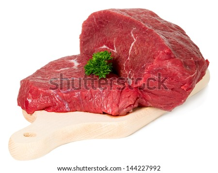 Raw sliced meat placed on cutting board, food concept - stock photo