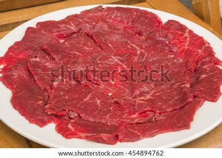 Raw sliced ox red meat - stock photo