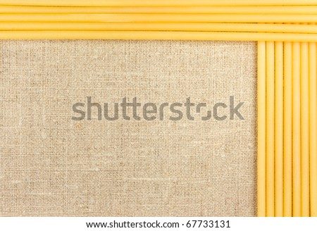 Raw spaghetti on the burlap background - stock photo