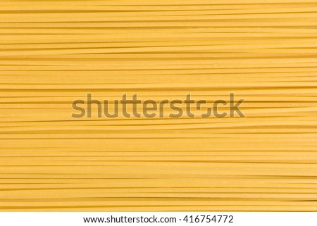 Raw spaghetti pasta background - stock photo