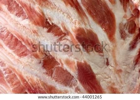Raw spare ribs in details as background