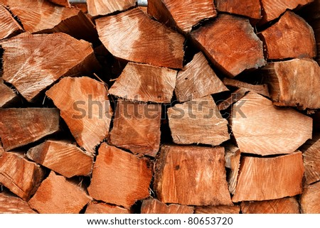 Raw split cedar wood logs cut to length in a lumber storage yard - Western Oregon. old growth salvaged timber stacked and ready to be sawn into shakes and shingles for use in building construction - stock photo