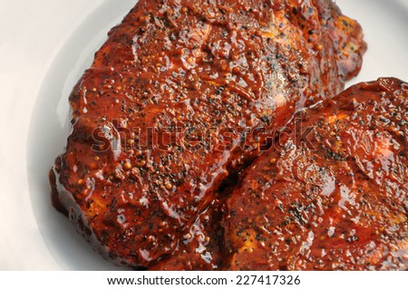 raw steak with red sauce