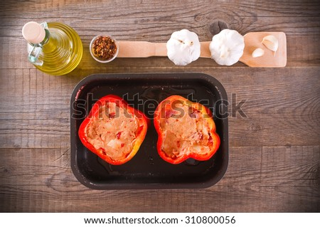 Raw stuffed peppers. - stock photo