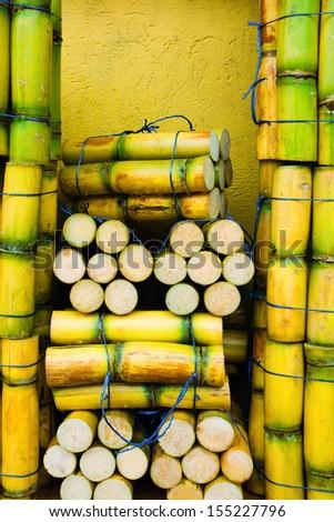 Raw sugar cane background - stock photo