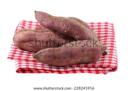 Raw Sweet Potato with dirt on skin, isolated on white - stock photo
