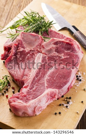 raw t-bone steak - stock photo