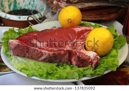 Raw T-Bone steak, a typical italian meal called Fiorentina - stock photo