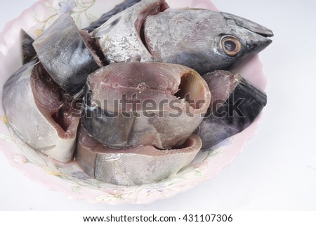 Raw Tuna fish isolated on white. DOF and copy space - stock photo