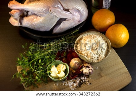 Raw turkey with traditional brazilian ingredients. Preparation of traditional Christmas food. - stock photo
