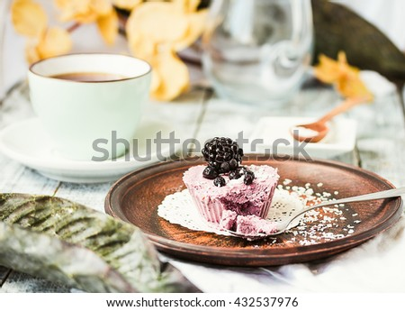 raw vegan berry cheesecake with coconut, portioned, light background, healthy lifestyle concept