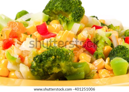 raw vegetable mix on the yellow plate