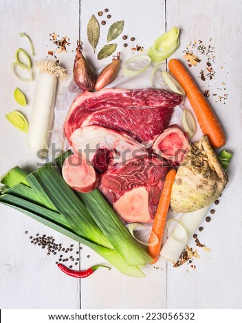 raw vegetables and meat set with  herbs and spices, ingredient for broth or soup, food background top view - stock photo