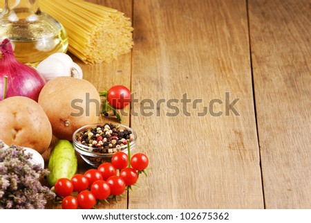 Raw vegetables olive oil pasta and spices - stock photo